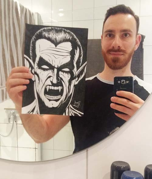 holding a drawing in a mirror