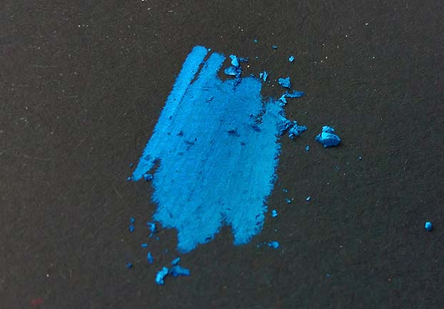 colored pencil residue on black paper